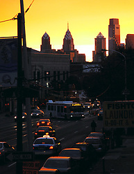 Sun sets over the Philly Skyline with Girard Avenue in the foreground.