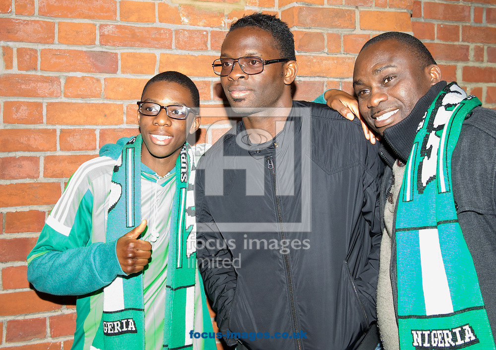 Louis Saha poses with Nigerian fans before the International Friendly match at Craven Cottage, London<br /> Picture by Alan Stanford/Focus Images Ltd +44 7915 056117<br /> 28/05/2014