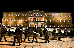 Riot police guard in front of the Greek Parliament during a demonstration,  in Athens, Greece on Friday, December. 6, 2019 commemorating the killing of 15-year-old student Alexandros Grigoropoulos by a police officer in 2008. Authorities are closing off main roads and have tightened security in the Greek capital.<br /> <br /> Pictured: <br /> Dimitris Lampropoulos    EEm date