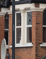 © Licensed to London News Pictures. 28/04/2017. London, UK. Bullet holes in the upstairs window of a property in Willesden, North London which was raided by anti-terror police in the early hours of this morning. A woman was shot and four people were arrested in the raid. Photo credit: Graham Eva/LNP