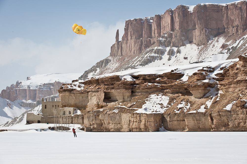Mike Libecki kite skis across the frozen lake at Band-e Amir National Park.