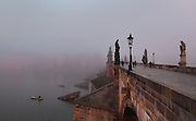 The Charles Bridge or Karluv most at dawn, built 1357 - 15th century, and the Vtlava river, Prague, Czech Republic. Its construction began under King Charles IV, replacing the old Judith Bridge built 1158'??1172 after flood damage in 1342. This new bridge was originally called the Stone Bridge (Kamenny most) or the Prague Bridge (Prazsky most) but has been the Charles Bridge since 1870. The bridge is 621m long and nearly 10m wide, resting on 16 arches shielded by ice guards, seen here. It is protected by three bridge towers, two on the Lesser Quarter side and one on the Old Town side. The historic centre of Prague was declared a UNESCO World Heritage Site in 1992. Picture by Manuel Cohen