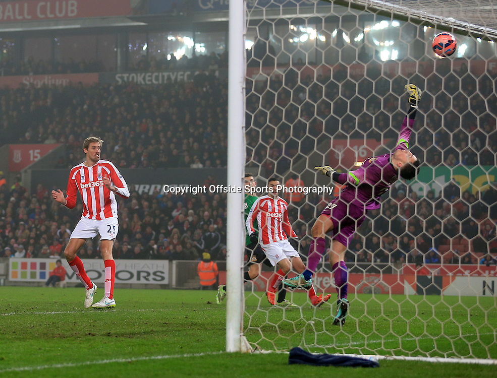 4th January 2015 - FA Cup - 3rd Round - Stoke City v Wrexham - Wrexham goalkeeper Jon Flatt saves from Peter Crouch of Stoke - Photo: Simon Stacpoole / Offside.