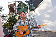 A one hand band street busker on George Street in the historic district in St. Augustine, Florida. St Augustine is the oldest city in America.