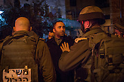 Palestinian human rights defender Issa Amro speaks to a military commander who refused to intervene when a settler attacked Palestinians and international volunteers during an evening of commemorate activities in Hebron.