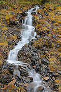 Waterfall along the Dempster Highway in the Tombstone Range (Ogilvie Mountains)<br />