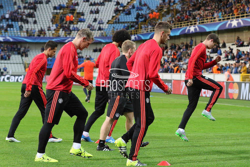 Manchester United Players warming up before the Champions League Qualifying Play-Off Round match between Club Brugge and Manchester United at the Jan Breydel Stadion, Brugge, Belguim on 26 August 2015. Photo by Phil Duncan.