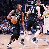 01 April 2018: Milwaukee Bucks forward Khris Middleton (22) drives past Denver Nuggets forward Juan Hernangomez (41) on a screen set by Milwaukee Bucks center Tyler Zeller (44) during the Denver Nuggets 128-125 victory over the Milwaukee Bucks, at the Pepsi Center, Denver, Colorado, USA.