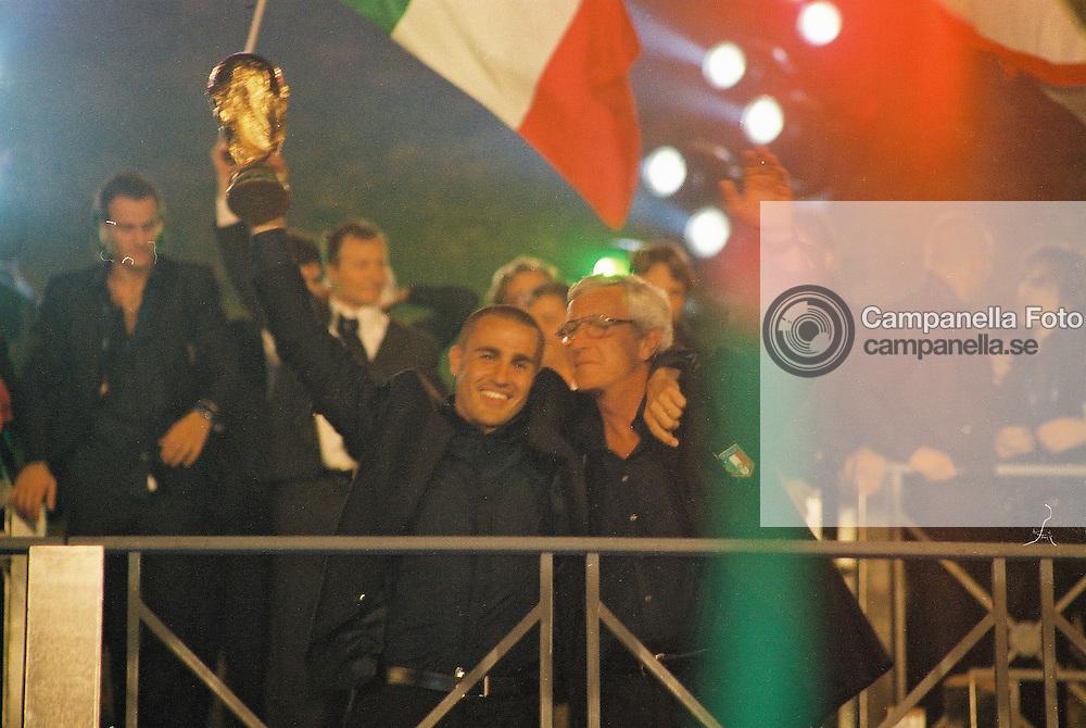 Rome 2006-07-10: <br /> <br /> Italy team captain Fabio Cannavaro alongside Italy head coach Marcello Lippi present the World Cup at the Circo Massimo in Rome, Italy.<br /> <br /> (Photo: Michael Campanella)
