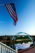 American flag flies over the Alabama River and the Edmund Pettus Bridge, an American Civil Rights Movement Landmark.