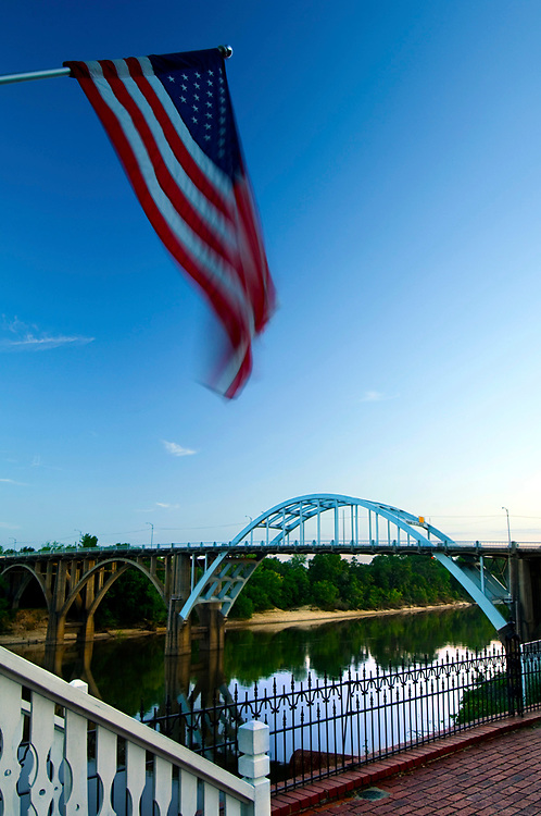 American flag flies over the Alabama River and the Edmund Pettus Bridge, an American Civil Rights Movement Landmark.