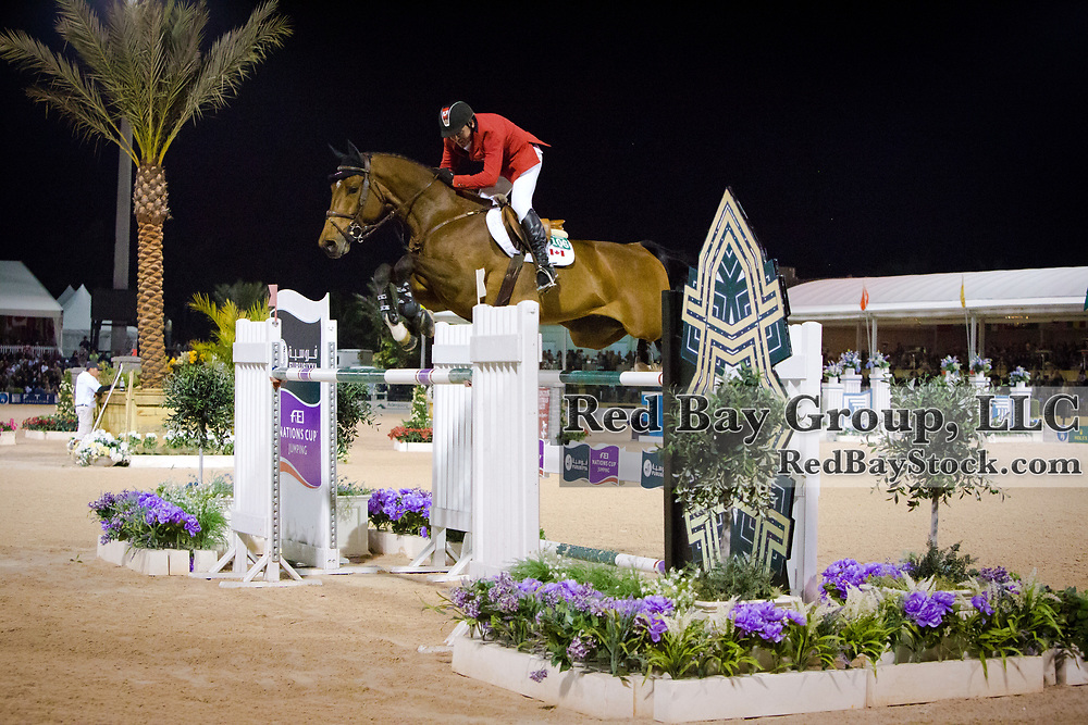 Eric Lamaze (CAN) and Powerplay at the 2014 Furusiyya FEI Nations Cup held during the Winter Equestrian Festival in Wellington, Florida.