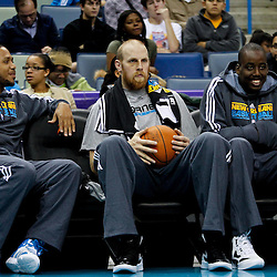 December 17, 2011; New Orleans, LA, USA; New Orleans Hornets players Eric Gordon, Chris Kaman and Al-Farouq Aminu watch from the bench during a scrimmage at the New Orleans Arena.   Mandatory Credit: Derick E. Hingle-US PRESSWIRE