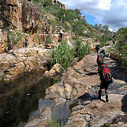 Students travel up a small canyon during a hiking section of their Australian Semester with the National Outdoor Leadership School,  in Drysdale National Park,  Kimberly region, Australia. Photo by Jen Klewitz