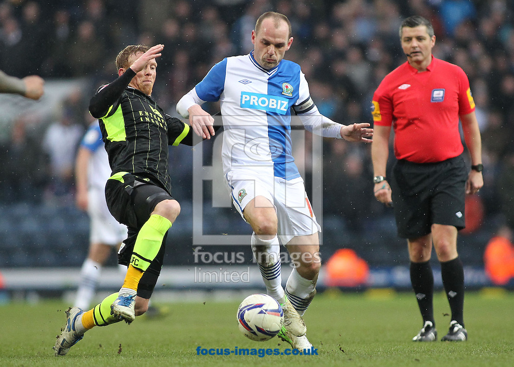 Picture by Michael Sedgwick/Focus Images Ltd +44 7900 363072.23/02/2013.Danny Murphy of Blackburn Rovers is tackled by Paul Green of Leeds United during the npower Championship match at Ewood Park, Blackburn.