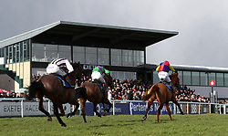 Golden Sunrise ridden by Paddy Brennan crosses the line to win the 188Bet Daily Racing Specials 'National Hunt' Novices' Hurdle during Super Sunday at Exeter Racecourse