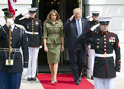April 27, 2017 - Washington, District of Columbia, United States of America - United States President Donald J. Trump and first lady Melania Trump depart the South Portico to welcome President Mauricio Macri of Argentina and his wife, Juliana Awada to the White House in Washington, DC on Thursday, April 27, 2017..Credit: Ron Sachs / CNP (Credit Image: © Ron Sachs/CNP via ZUMA Wire)