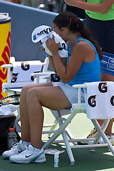 July 31, 2011; Stanford, CA, USA;  Marion Bartoli (FRA) reacts after the match against Serena Williams (USA), not pictured, during the finals of the Bank of the West Classic women's tennis tournament at the Taube Family Tennis Stadium. Williams defeated Bartoli 7-5, 6-1.