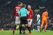 Wayne Rooney with blood on his face Forward of Manchester United argues with Referee Michael Jones during the EFL Cup Quater-Final between Manchester United and West Ham United at Old Trafford, Manchester, England on 30 November 2016. Photo by Phil Duncan.