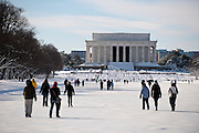 Tourists walk on the frozen reflecting pool in front of the Lincoln Memorial in Washington D.C. following the bizzard of 2010.