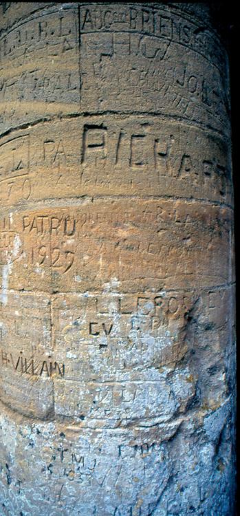 France, Normandy.  Abbaye de Hambye.  Close up of pillar graffiti.