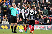 Referee Sebastian Stockbridge waves away Grimsby Town midfielder Siriki Dembele (27)  during the EFL Sky Bet League 2 match between Grimsby Town FC and Port Vale at Blundell Park, Grimsby, United Kingdom on 10 March 2018. Picture by Mick Atkins.