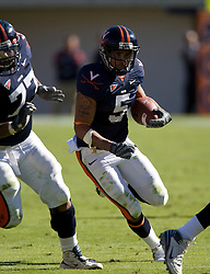 Virginia tight end Mikell Simpson (5) rushes in front of Virginia center Ian-Yates Cunningham (77). The #23 Virginia Cavaliers defeated the #24 Wake Forest Demon Deacons 17-16 at Scott Stadium in Charlottesville, VA on November 3, 2007.