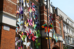 © Licensed to London News Pictures. 24/08/2019. London, UK. A building covered with colourful butterflies on Ladbroke Grove up ahead of the 2019 Notting Hill Carnival which takes place this weekend and on bank holiday Monday. Up to 1 million people are expected to attend the biggest street party in Europe. Photo credit: Dinendra Haria/LNP