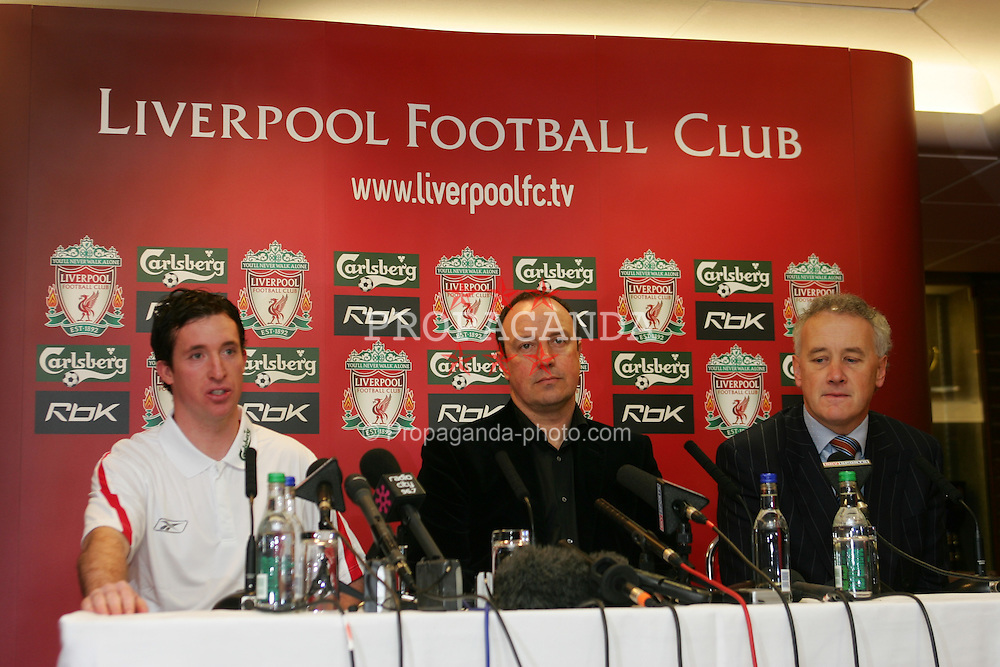 LIVERPOOL, ENGLAND - MONDAY, JANUARY 30th, 2006: Liverpool's new signing Robbie Fowler with manager Rafael Benitez (C) and Chief-Executive Rick Parry (R) at a press conference at Anfield following his free transfer from Manchester City back to his home town club. (Pic by David Rawcliffe/Propaganda)