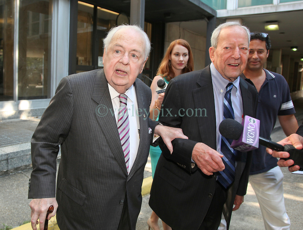 03 June  2015. New Orleans, Louisiana. <br /> Tom Benson, billionaire owner of the NFL New Orleans Saints, the NBA New Orleans Pelicans, various auto dealerships, banks, property assets and a slew of business interests leaves New Orleans Civil District Court with his attorney Phillip Whitman where they are attending a hearing to determine Benson's level of competency to manage his business empire. Benson changed his succession plans and  decided to leave the bulk of his estate to third wife Gayle, sparking a controversial fight over control of the Benson business empire.<br /> Photo&copy;; Charlie Varley/varleypix.com