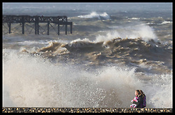 January 3, 2018 - Brighton, United Kingdom - A young girl keeps a tight hold of her cuddly toy as giant waves crash into the beach in Brighton,Sussex, as Storm Eleanor hits the UK  (Credit Image: © Stephen Lock/i-Images via ZUMA Press)