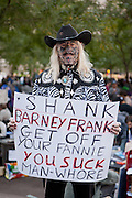 A man in a western shirt and a tattooed face has unkind words for Rep. Barney Frank (D-Mass.), ranking member of the Committee on Fnancial Services.