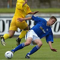 Montrose v St Johnstone....10.07.04<br />Stephen Fraser tackles Martin Wood<br /><br />Picture by Graeme Hart.<br />Copyright Perthshire Picture Agency<br />Tel: 01738 623350  Mobile: 07990 594431