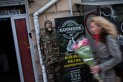 Crimea one day before the referendum. A pedestrian walks in front of a military shop. Simferopol, . Saturday, 15th March 2014. Picture by Daniel Leal-Olivas / i-Images