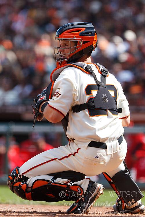 April 8, 2011; San Francisco, CA, USA;  San Francisco Giants catcher Buster Posey (28) checks a St. Louis Cardinals runner at third base during the sixth inning at AT&T Park.