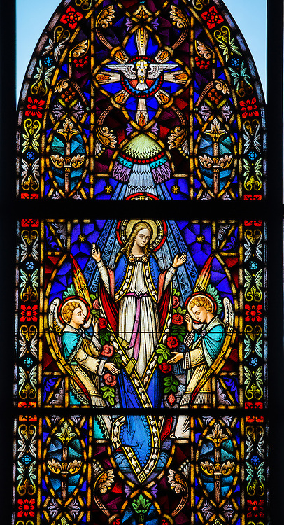 Stained glass window at Holy Family Church in Brillion, Wis. Assumption of the Virgin Mary. (Sam Lucero photo)