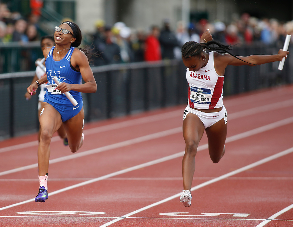 Kentucky's Kianna Gray, left, beats Alabama's Takyera Roberson, right, on the final legs of the women's 4x100 meters relay on the final day of the NCAA outdoor college track and field championships in Eugene, Ore., Saturday, June 10, 2017. Kentucky won the race in the time of 42.51 seconds, with Alabama finishing second in the time of 42.56 seconds. (AP Photo/Timothy J. Gonzalez)