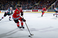 KELOWNA, CANADA - MARCH 2:  Seth Jarvis #24 of the Portland Winterhawks skates with the puck with Conner Bruggen-Cate #20 of the Kelowna Rockets in pursuit during first period on March 2, 2019 at Prospera Place in Kelowna, British Columbia, Canada.  (Photo by Marissa Baecker/Shoot the Breeze)