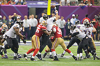3 February 2013: Quarterback (5) Joe Flacco of the Baltimore Ravens passes as he is hit by (55) Ahmad Brooks and (99) Aldon Smith of the San Francisco 49ers during the second half of the Ravens 34-31 victory over the 49ers in Superbowl XLVII at the Mercedes-Benz Superdome in New Orleans, LA.