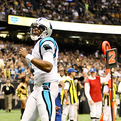 January 1, 2012; New Orleans, LA, USA; Carolina Panthers quarterback Cam Newton (1) reacts after throwing a touchdown pass against the New Orleans Saints during the first quarter of a game at the Mercedes-Benz Superdome. Mandatory Credit: Derick E. Hingle-US PRESSWIRE