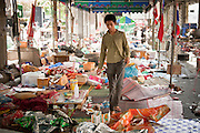 20 MAY 2010 - BANGKOK, THAILAND: A Thai teenager walks through the remains of the Red Shirt camp in the Ratchaprasong Intersection in Bangkok Thursday. The day after a military crackdown killed at least six people, Thai authorities continued mopping up operations around the site of the Red Shirt rally stage and battle fires set by Red Shirt supporters in the luxury malls around the intersection. PHOTO BY JACK KURTZ