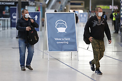 © Licensed to London News Pictures. 15/06/2020. London, UK. Passengers wear face masks as they arrive at Waterloo Sation. New rules allowing some non-essential retail businneses to open and mandatory face masks on public transport have started today. Photo credit: Peter Macdiarmid/LNP