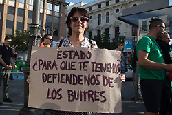 October 6, 2018 - Madrid, Spain - Activist seen holding a poster written State, what do we have you for during the protest..The Anti-Eviction Platform (PAH) demonstrates through the streets of Madrid for the approval of The Five, a series of measures presented in the Congress for the paralysis of all evictions, expropriation as a useful tool to recover the housing from the hands of vultures and its control of rental prices. (Credit Image: © Lito Lizana/SOPA Images via ZUMA Wire)