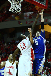 13 January 2012:  John Wilkins defends a shot offered by Doug McDermott during an NCAA Missouri Valley Conference mens basketball game where the Creighton Bluejays topped the Illinois State Redbirds 87-78 in Redbird Arena, Normal IL