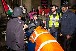 London, UK. 8th February, 2019. A police officer tells pro-Palestinian activists attending a 'Love Eurovision, Hate Apartheid!' protest outside BBC Broadcasting House organised by London Palestine Action that they would not be able to use a portable sound system. They were calling on the BBC to withdraw from the 2019 Eurovision Song Contest hosted by Israel so as to avoid complicity in 'artwashing' Israel's violations of Palestinian human rights. The protest formed part of a global campaign to Boycott Eurovision in Israel.