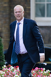 © Licensed to London News Pictures. 09/10/2018. London, UK.  Chris Grayling,<br /> Secretary of State for Transport arrives in Downing Street for a cabinet meeting.  Photo credit: Vickie Flores/LNP