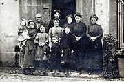 early 1900s 3 generation mainly female family standing in front of house France