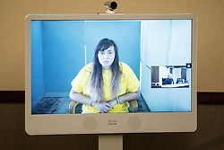 July 26, 2017 - Los Banos, California, U.S. - OBDULIA SANCHEZ, 18, of Stockton, appears over a video feed before Judge David Moranda, as she is arraigned on charges of gross vehicular manslaughter and DUI,  at the Robert M. Falasco Justice Center. Sanchez was driving a white Buick Century when she crashed the car outside of Los Banos, Friday evening, resulting in the death of her 14-year-old sister Jacqueline Sanchez, who authorities said wasn't wearing a seat belt and was ejected through the back window of the car. (Credit Image: © Andrew Kuhn/The Merced Sun Star via ZUMA)