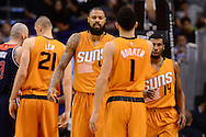 Apr 1, 2016; Phoenix, AZ, USA; Phoenix Suns center Tyson Chandler (4) is congratulated by teammate guard Devin Booker (1) in the first half of the game against the Washington Wizards at Talking Stick Resort Arena. Mandatory Credit: Jennifer Stewart-USA TODAY Sports