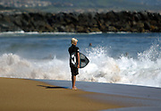 Young Skim Boarder Waiting For A Wave